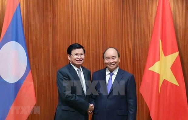 Le Premier ministre lao au Vietnam pour renforcer les liens hinh anh 1
