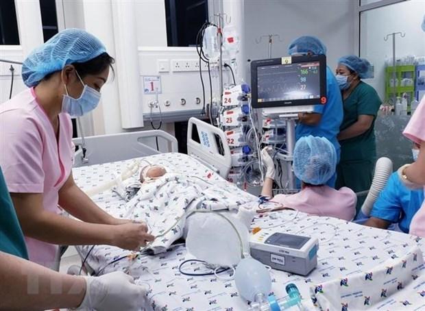 Ho Chi Minh-Ville: operation de separation reussie des sœurs siamoises hinh anh 2