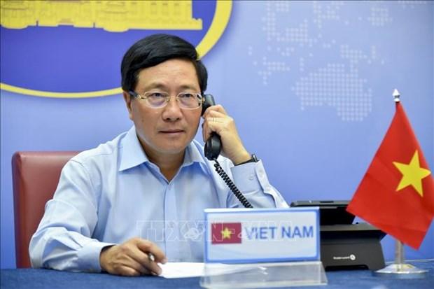 Conversation telephonique entre les chefs de la diplomatie Vietnam-R. de Coree hinh anh 1
