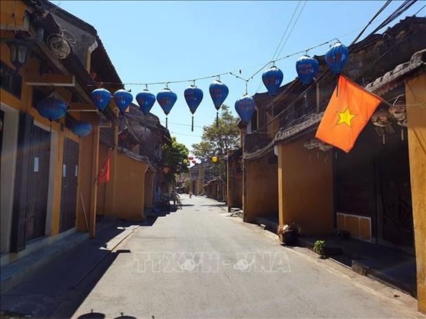 COVID-19 : mise en place de la distanciation sociale dans la ville de Hoi An hinh anh 1