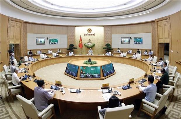 Le PM preside une visioconference nationale sur la lutte anti-coronavirus hinh anh 1