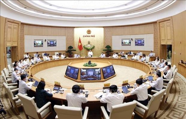 Gouvernement : reunion periodique portant sur la lutte contre le coronavirus et le developpement economique hinh anh 1
