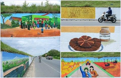 Hanoi : a Phuc Tho, les murs revetent de nouvelles fresques hinh anh 1