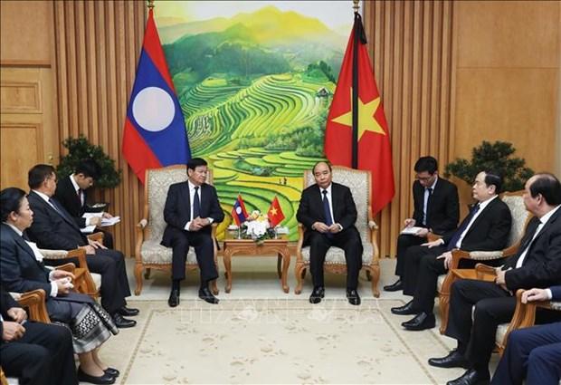 Le PM Nguyen Xuan Phuc rencontre son homologue laotien a Hanoi hinh anh 1