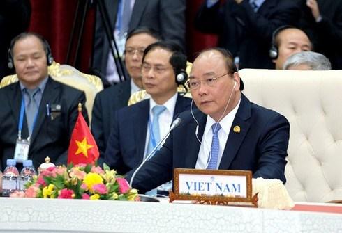 Le PM participera au Sommet de cooperation Mekong-Lancang hinh anh 1