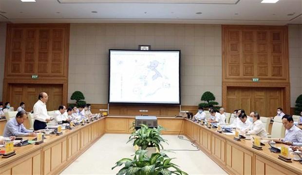 Le PM preside une seance de travail avec Ho Chi Minh-Ville hinh anh 1