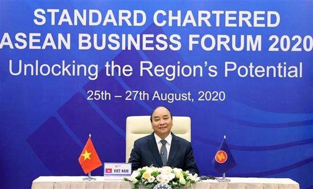 Le PM participe au Forum d'affaires de l'ASEAN Standard Chartered 2020 hinh anh 1