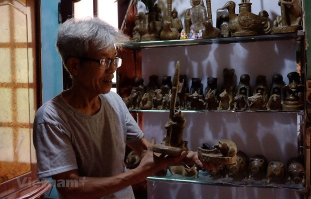 L'artisan qui perpetue l'heritage de la fabrication de figurines d'argile hinh anh 1