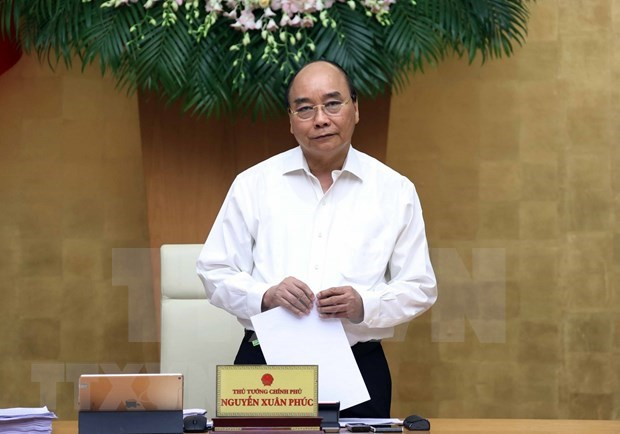 Le gouvernement poursuit la lutte contre le COVID-19 et le developpement economique hinh anh 1