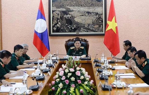 Vietnam et Laos cherchent a renforcer la cooperation en matiere de defense hinh anh 1