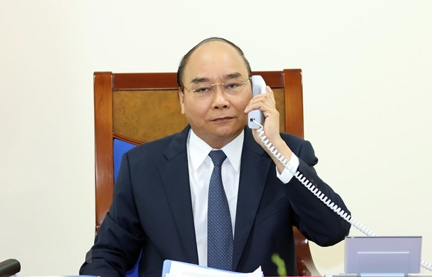 Conversation telephonique entre Nguyen Xuan Phuc et Angela Merkel hinh anh 1