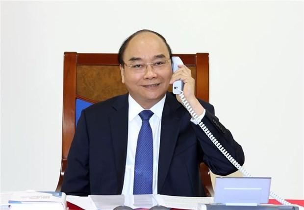 Vietnam-Japon : conversation telephonique entre les Premiers ministres hinh anh 1
