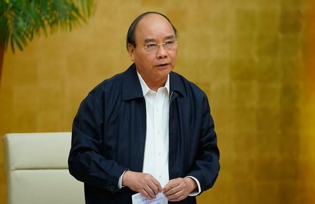 Le PM Nguyen Xuan Phuc demande de redoubler d'efforts pour faire avancer le pays hinh anh 1