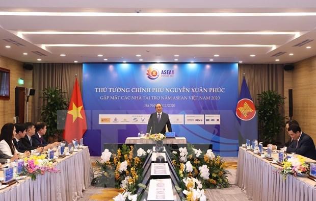 Le PM Nguyen Xuan Phuc rencontre les sponsors du 37e Sommet de l'ASEAN hinh anh 1