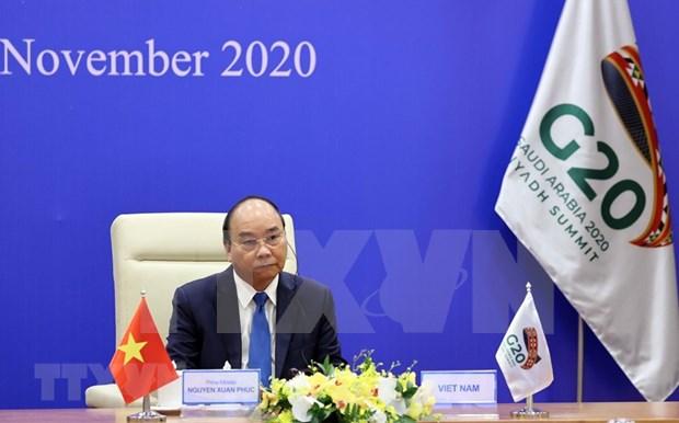 Le Premier ministre Nguyen Xuan Phuc assiste au Sommet virtuel du G20 hinh anh 3