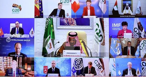 Le Premier ministre Nguyen Xuan Phuc assiste au Sommet virtuel du G20 hinh anh 2