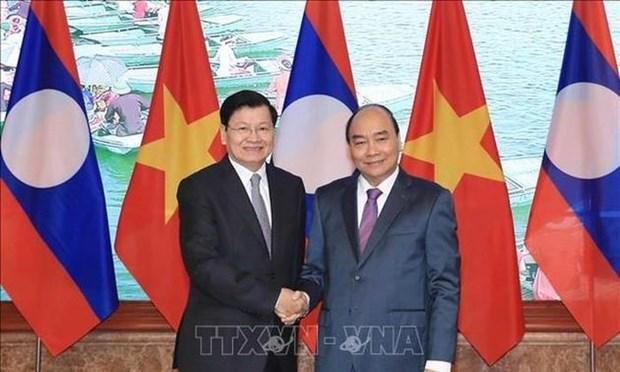 Le PM lao au Vietnam pour la 43e session du Comite intergouvernemental hinh anh 1