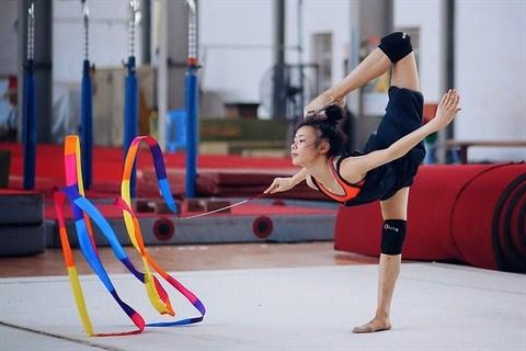Gymnastique rythmique : des sourires et des larmes. hinh anh 1