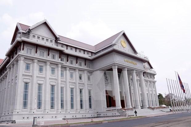 Remise du nouveau batiment de l'Assemblee nationale finance par le Vietnam au Laos hinh anh 1