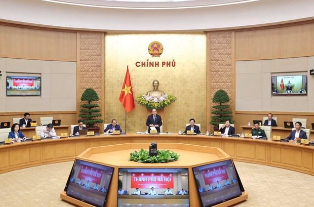 Le Premier ministre preside la reunion de mars du gouvernement hinh anh 1
