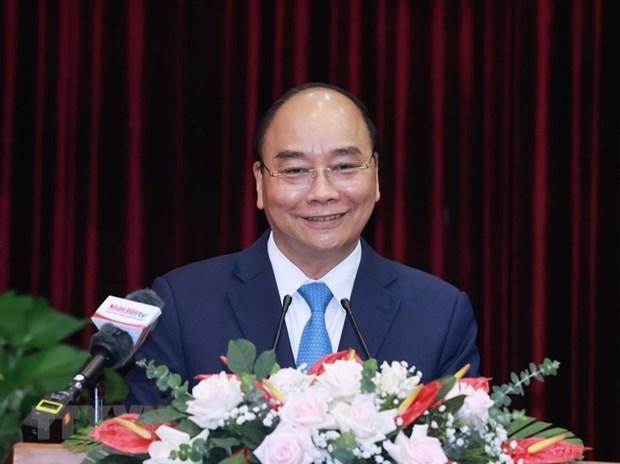 Le president Nguyen Xuan Phuc travaille avec Da Nang et Quang Nam hinh anh 1