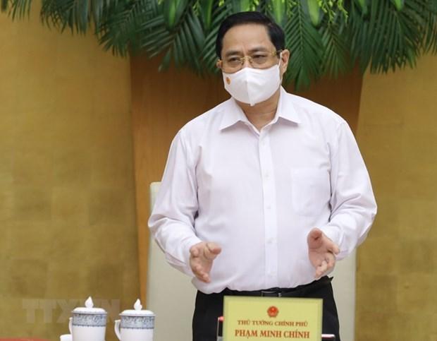 Le Premier ministre preside la reunion d'avril du gouvernement hinh anh 1