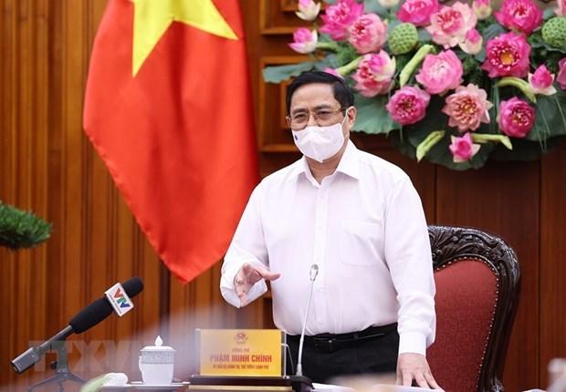 Le PM appelle a creer un fonds pour la vaccination contre le COVID-19 hinh anh 1