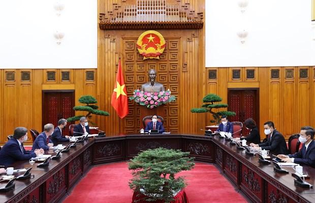 Le Premier ministre Pham Minh Chinh recoit le president de la COP 26 hinh anh 1