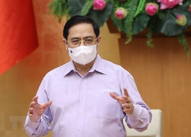 Le PM demande de repousser l'epidemie de Covid-19 dans les zones cles hinh anh 1