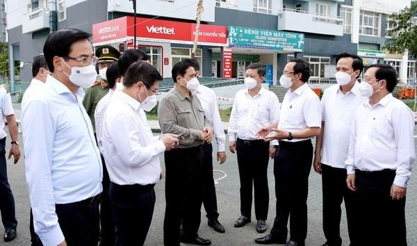 Le PM inspecte la lutte contre le Covid-19 a Ho Chi Minh-Ville hinh anh 1