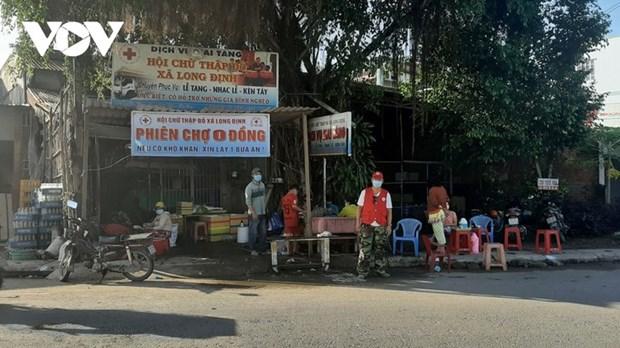 A Tien Giang, un marche gratuit pour conjurer la crise du coronavirus hinh anh 1