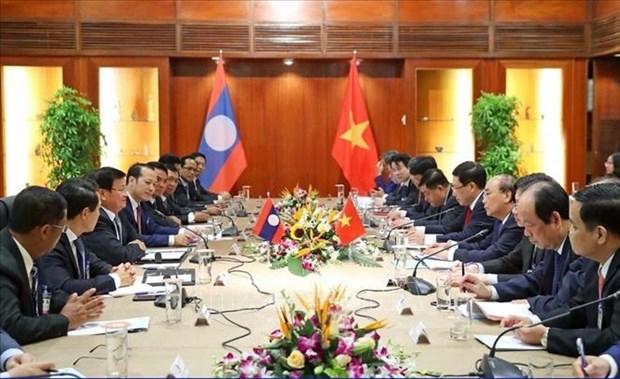 Les relations Laos-Vietnam louees sur le journal PathetLao hinh anh 1