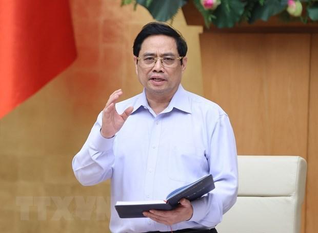 Le PM demande a toutes les forces de se concentrer sur la lutte anti-COVID-19 hinh anh 1