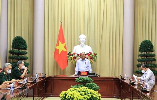 Le president affirme les politiques envers les meritants et les victimes de l'agent orange hinh anh 1