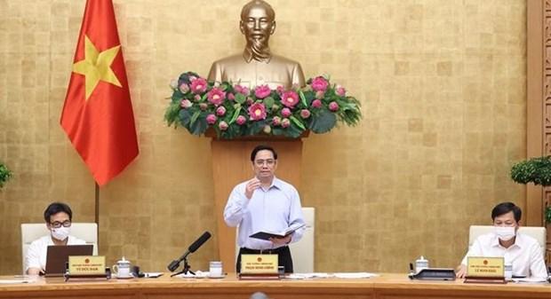 Le PM demande de nouvelles solutions dans la lutte anti-COVID-19 hinh anh 1