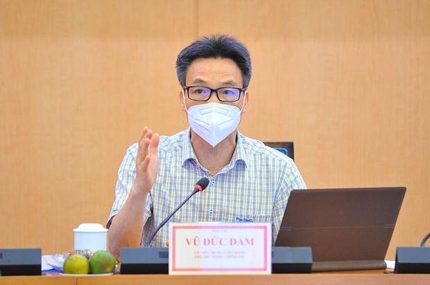 Inspection du travaux de prevention et de lutte anti-COVID-19 a Hanoi hinh anh 1