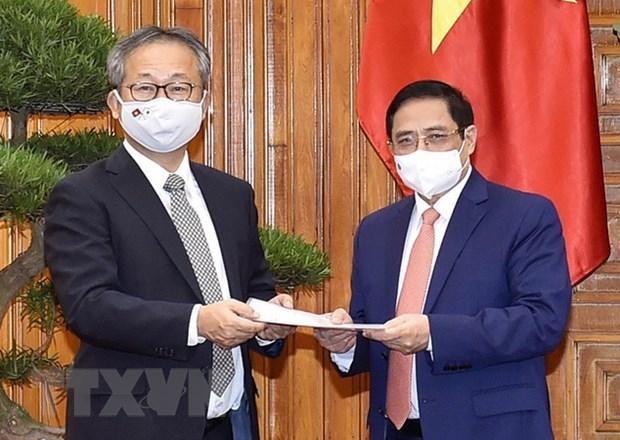 Le Premier ministre Pham Minh Chinh recoit l'ambassadeur du Japon au Vietnam hinh anh 1