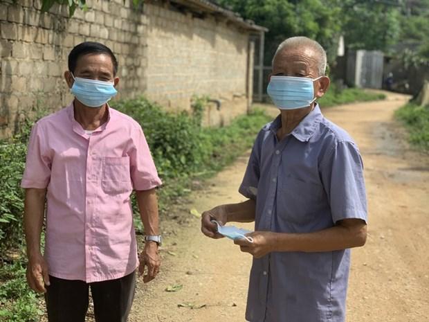 """Lam Van Mau, un """"haut-parleur vivant"""" contre la pandemie de Covid-19 hinh anh 1"""