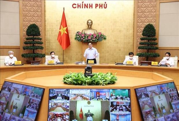 Le PM preside une reunion nationale en ligne sur la reponse au Covid-19 hinh anh 2