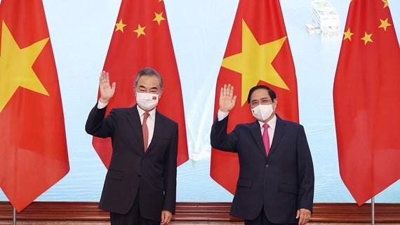 Le Vietnam attache de l'importance au developpement des relations avec la Chine hinh anh 1