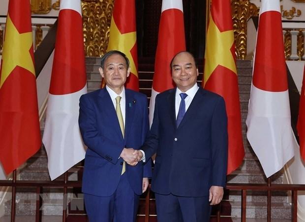 Le president Nguyen Xuan Phuc aura une conversation telephonique avec le PM japonais hinh anh 1