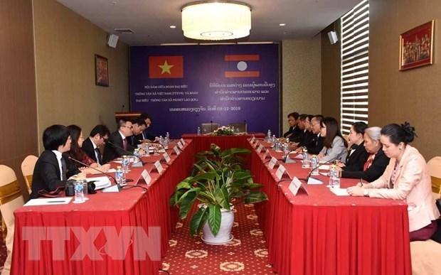 Cooperation etroite et durable entre la VNA et l'Agence de presse lao hinh anh 1