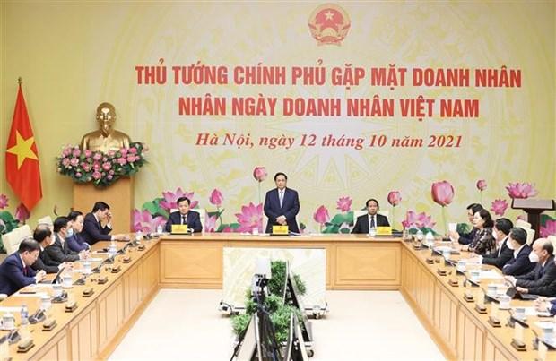 Le PM met en avant la foi des entreprises et la responsabilite du gouvernement hinh anh 1