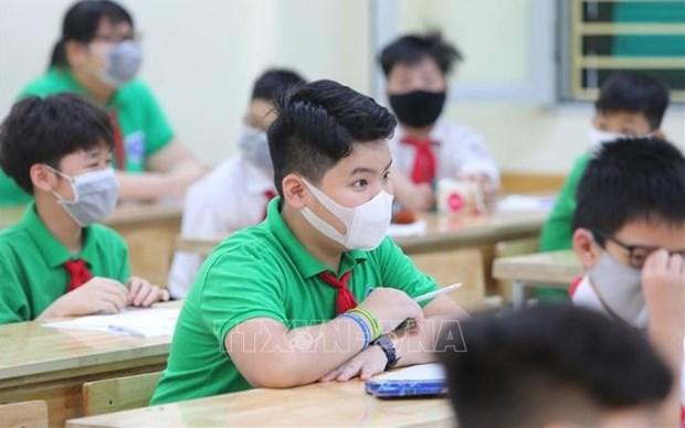 L'education nationale se prepare a un retour sur en classe hinh anh 2