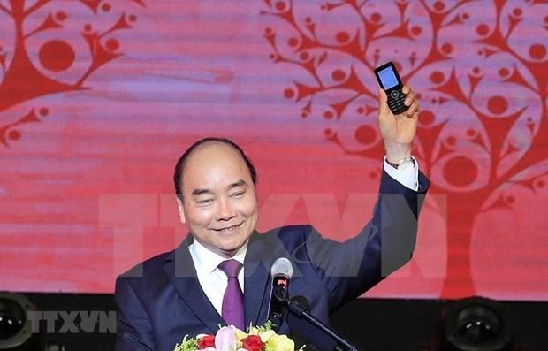 Le PM appelle les Vietnamiens a soutenir les pauvres avant le Tet hinh anh 1