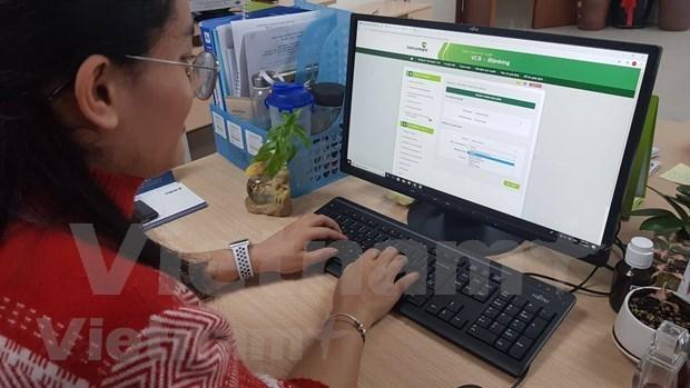 Paiement en ligne: le coronavirus pousse les banques a changer hinh anh 1