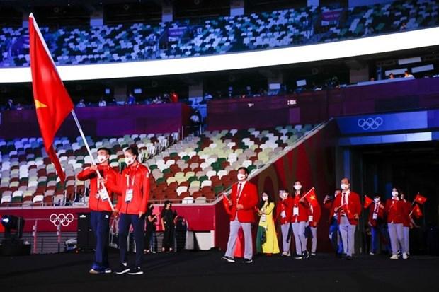 JO de Tokyo : la delegation vietnamienne defile a la ceremonie d'ouverture hinh anh 1