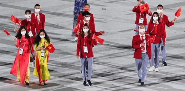 JO de Tokyo : la delegation vietnamienne defile a la ceremonie d'ouverture hinh anh 2