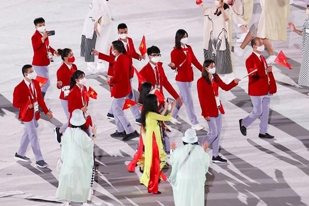 JO de Tokyo : la delegation vietnamienne defile a la ceremonie d'ouverture hinh anh 3